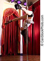 Stripper hanging on pole - Strip tease dancer hanging on the...