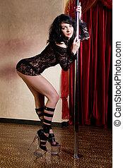 Stripper pole dancing - Strip tease dancer girl on stage in...