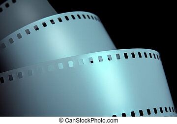 Strips of negative film strip on a dark background.