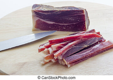 Strips of raw bacon