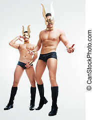 dancers wearing golden rabbit ears - striptease dancers...