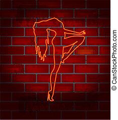 Striptease dancing girl - Neon image on a brick wall dancing...
