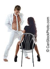 Striptease. Handsome man dancing in front of girl