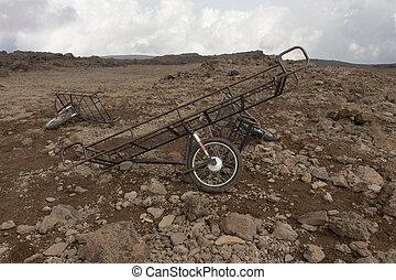 Stroller, stretcher lie on the stones