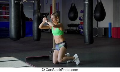 Strong and Fit Beautiful Girl in an Athletic Top is Doing...