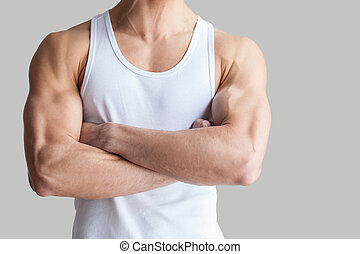 Strong and healthy body. Cropped image of muscular man...