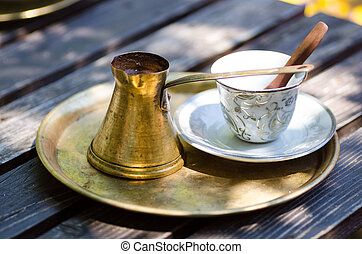 Strong and hot turkish coffee in traditional metal pot