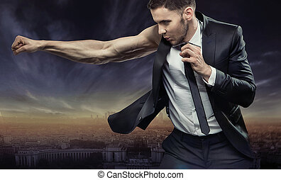 Strong and very muscular businessman over the city