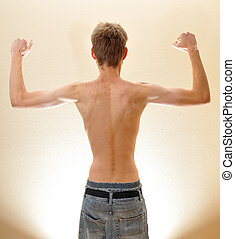 Strong arms and back - A strong young male flexing his arms ...