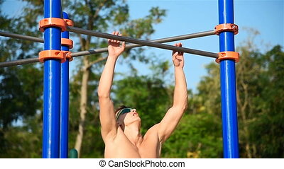 Athlete Doing Pull-up On Horizontal Bar - Strong Athlete...