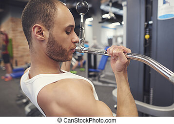 Strong athlete training biceps parts