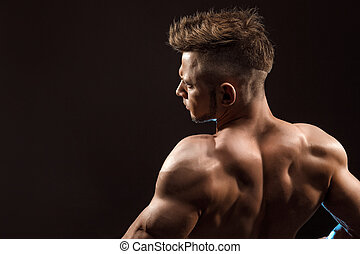 Strong Athletic Man Fitness Model posing back muscles,...