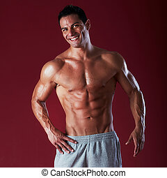 Strong Athletic Man Fitness Model Torso showing six pack abs
