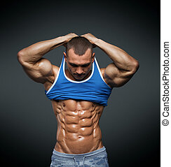 Strong Athletic Man Fitness Model Torso showing big muscles...