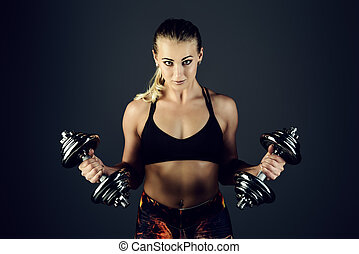 strong athletic woman - Muscular young woman with beautiful...