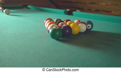 Strong blow to the center of the pyramid in American billiards HD Video