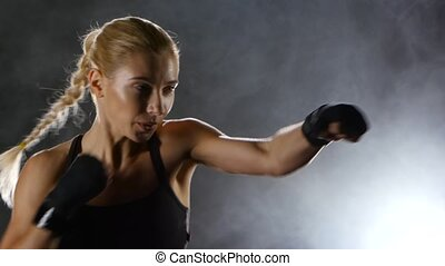 Strong blows by hands with fists of boxer sporswoman,...