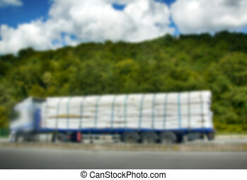Strong blurred unrecognizable truck transport
