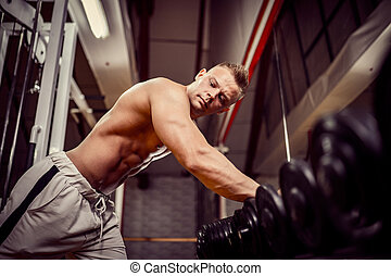 Strong Bodybuilder Doing Heavy Weight Exercise For Back