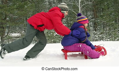 Strong Brother - Strong kid pushing his sister sitting on a...