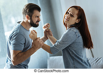 Strong brutal man holding his wife - Let me go. Strong ...
