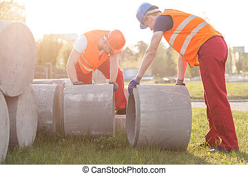 Strong builders with concrete tubes