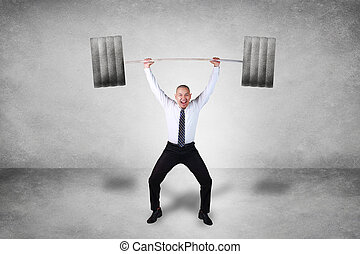 Strong Businessman Lifting Heavy Weight