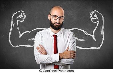 Strong Businessman - Muscles Drawn On Blackboard