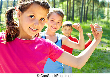 Strong children - Three little children posing at camera