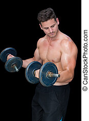 Strong crossfitter lifting heavy black dumbbells