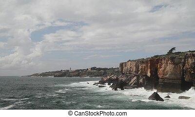 Strong extreme waves crash into grotto cliff cave, Boca do...