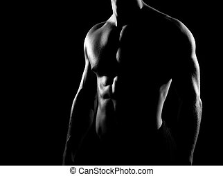 Strong, fit and sporty bodybuilder man in grayscale.