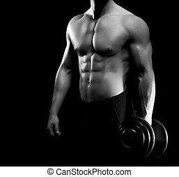 Strong, fit and sporty bodybuilder man with a dumbbell in grayscale.