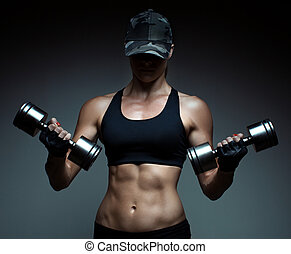 Strong fitness woman bodybuilder