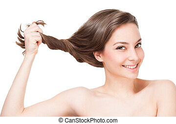 Strong full hair. - Portrait of a gorgeous young brunette...