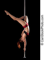 strong girl show gymnastic exercise in pole dance - strong...