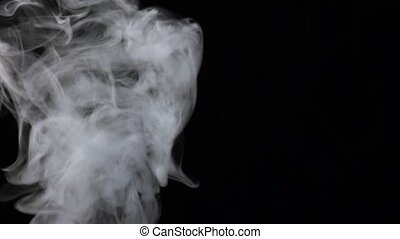 Strong jet of white mist streams from bottom, slow motion
