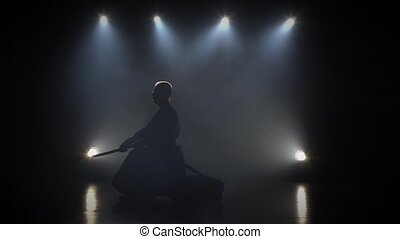 Strong Kendo guru practicing martial art with the Katana...