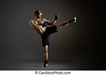 strong kick - Man in sportswear performing a kick. Martial...