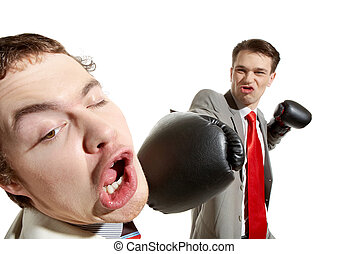 Strong kick - Portrait of aggressive businessman in boxing...