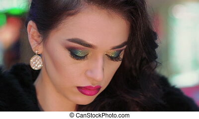 Strong look of elegant woman with cool make up. Close up. Slowly
