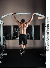 Strong man doing pull ups