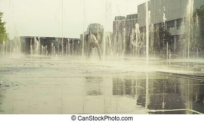 Strong man performing handstand in the fountain. Yoga asana...