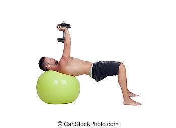Strong man practicing exercises with dumbbells sit on a ball