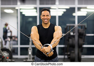 middle aged man doing triceps exercise