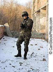 Strong military man with weapon