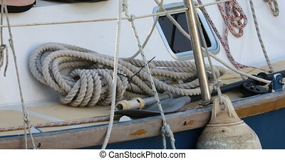 Strong Old-Fashioned Rustic Rope on The Deck of a Boat in...