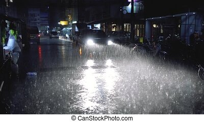 Strong Rain in the night city with car lights