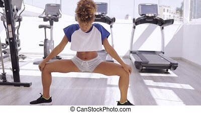 Strong sportswoman in gym - Sportive young ethnic model in...