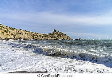 Strong surf on a sandy beach. Crimea.
